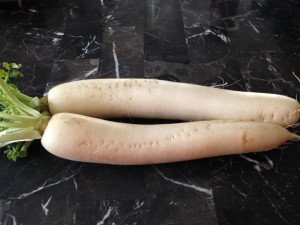 Daikon Radish. It makes your house stinky much like cooked cabbage and broccoli. It's great pickled but I love it in soup. It's sweet once cooked. You can even slice it thin and bake it as a snack.